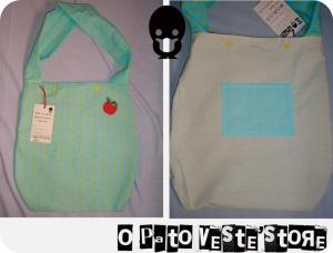 Bolsa de algodão, com aplicação de maçã, forro e bolso interno e dois botões de pressão p/ o seu fechamento.